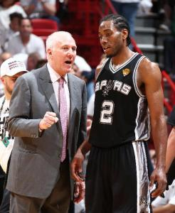 Kawhi Leonard receiving instruction from Coach Pop (click to enlarge).