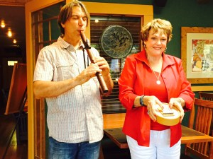 Mary Ann playing an instrument to accompany Johnny on the flute. We never knew she could play a musical instrument!