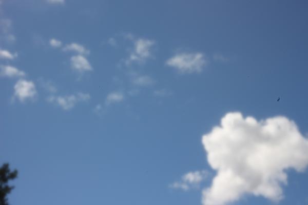 pinhole-lens-image-100D-clouds