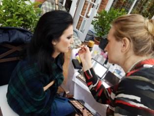 Model Ana Maria getting made up by Aga Malinowska