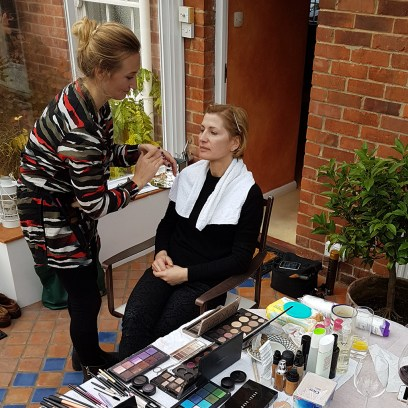 Lacry Couture designer being made up