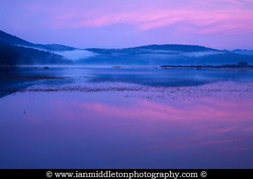 Cerknica lake at dawn, Notranjska, Slovenia. Cerknica is one of many seasonal lakes in the Karst of Western Slovenia, which is a huge limestone landscape. Cerknica is the biggest of the Slovenian seasonal lakes and when completely full is the largest lake in Slovenia.
