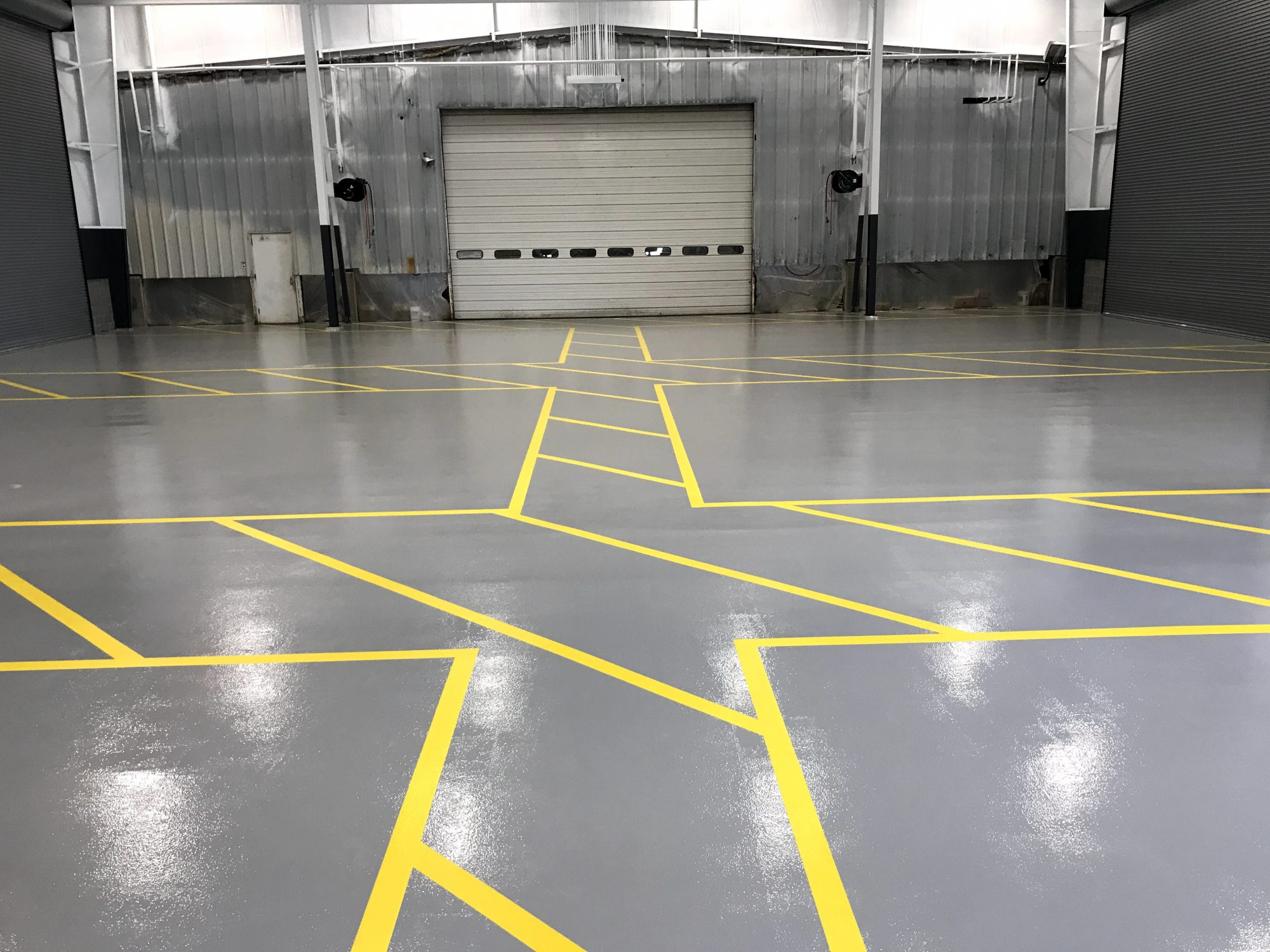 safety striping, epoxy line striping, epoxy floor coatings, degreased, shotblasted
