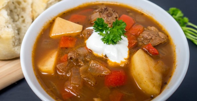 This German goulash recipe is full of hearty vegetables and flavorful beef