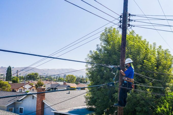 Worker outside working on a power line