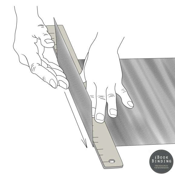 Figure 120 - Using a Metal Ruler to Fold Paper Correctly