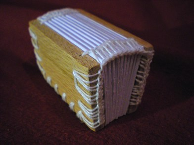 chunky coptic headband example around entire cover board - bookbinding