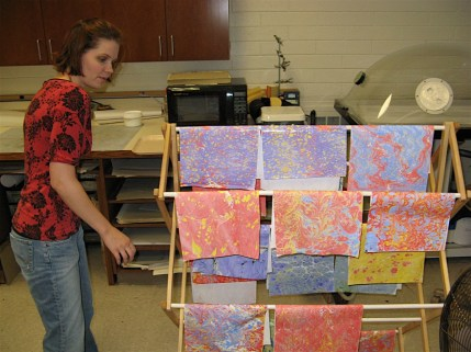 Marbled Paper Hanging up to Dry Photo by Lili's Bookbinding Blog - http://lilbookbinder.wordpress.com/marbled-paper/