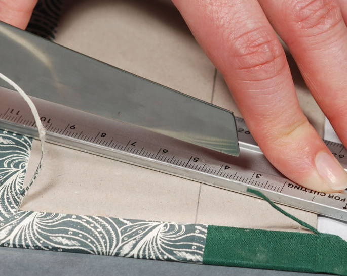 Cutting-Excess-Cover-Material-from-Binding-Board---Bookbinding-Instruction