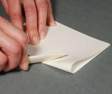 Folding-Paper-with-Bonefolder---Making-Bookbinding-Signatures
