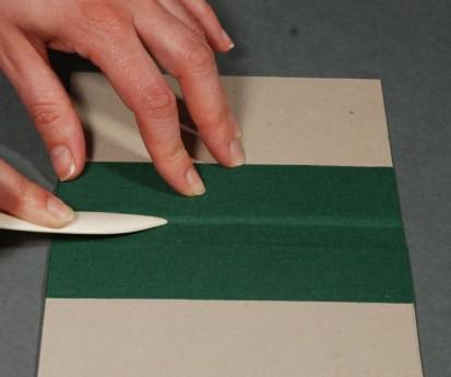 Gluing-Spine-Covering-Material-to-Binders-Board