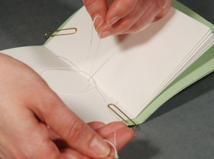 Tying-Knot-in-Bookblock-after-Sewing-Signatures