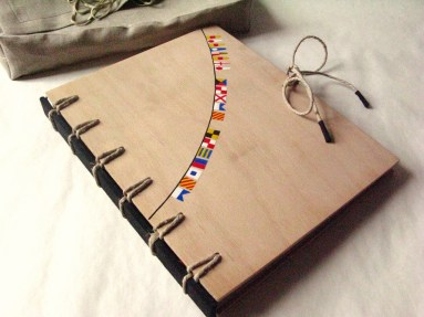 Natural Wooden Crisscross Bound Book with Flags by AskIda - https://www.flickr.com/photos/askida/4973632809/