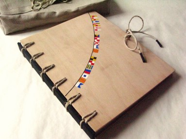 Natural Wooden Crisscross Bound Book with Flags by AskIda - https://www.flickr.com/photos/askida/4973632809/