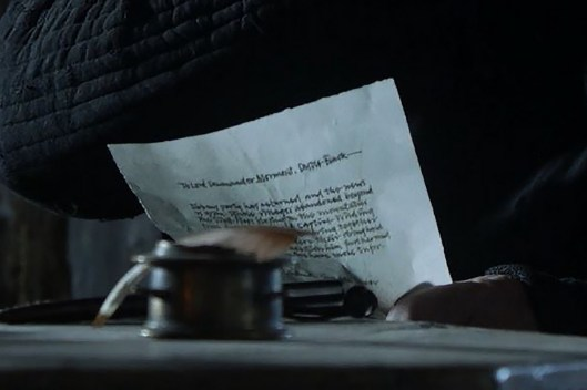 GoT S01E10 00.42.35 - Mormont reading a lettter - close-up