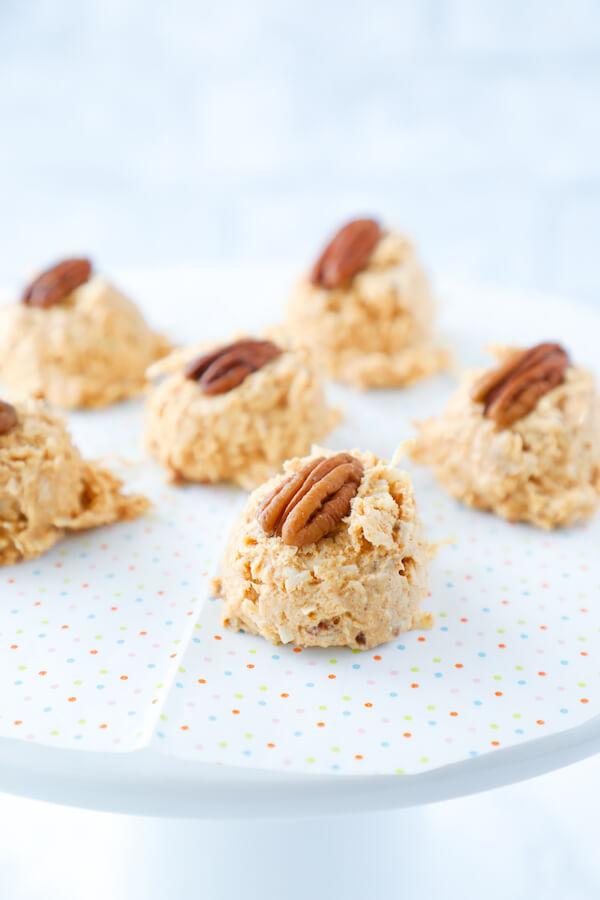 keto desserts, No bake Keto Pumpkin Spice Haystack Cookies on white pedestal