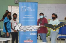 IBSU students participating in the Drone Workshop with the Trainer displaying some of the drones.