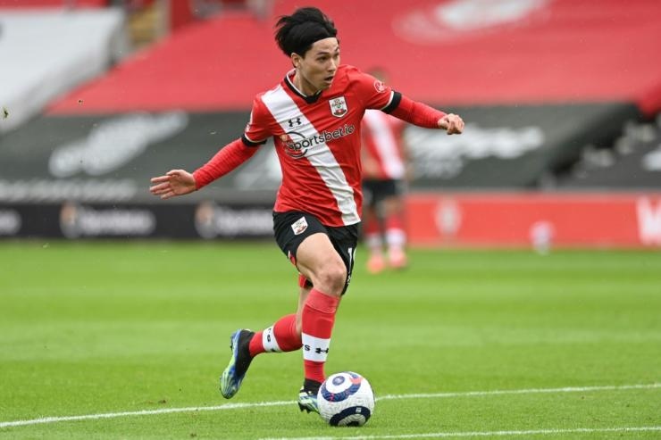 Loan ranger: On-loan Liverpool midfielder Takumi Minamino helped his parent club with the opener against Chelsea