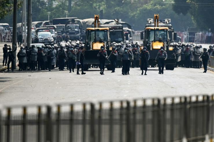 Myanmar police advance towards protesters in Yangon demonstrating against the coup