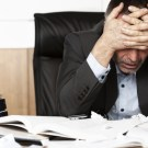 Frustrated office manager overloaded with work.