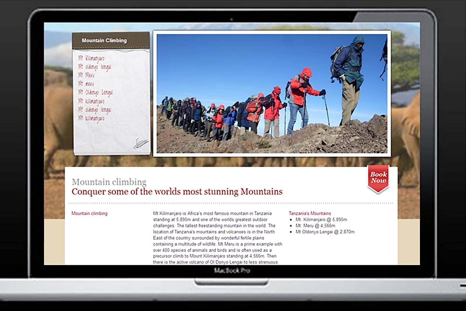 laptop screen showing people mountain climbing