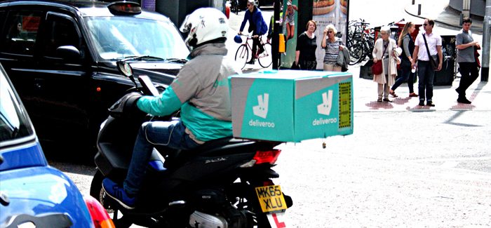A Deliveroo Moped Delivery Rider Driver