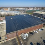 removal and installation of 50,000 square feet of 60 MIL PVC roofing system