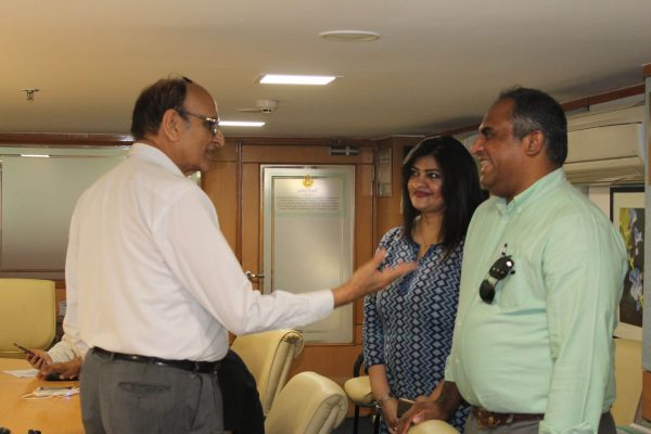 Dr. VK Singh, Ms. Suruapa Chakrabarti and Dr. Denny John interacting with each other