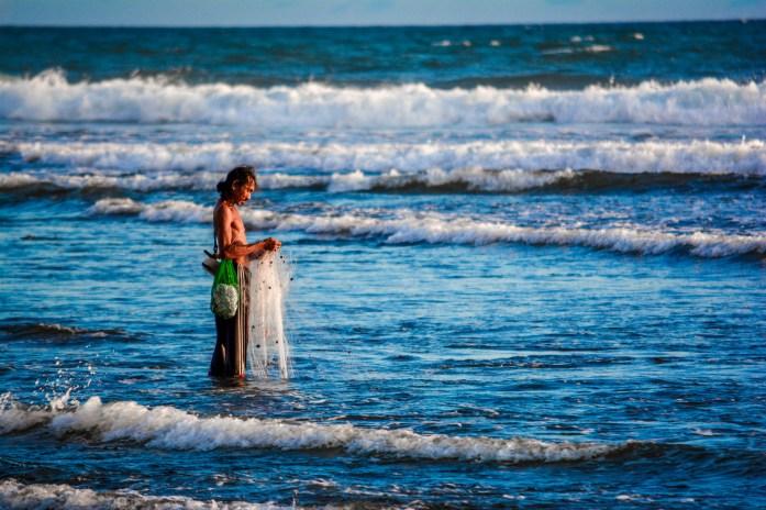 Pêcheur Balian Beach Bali coucher de soleil