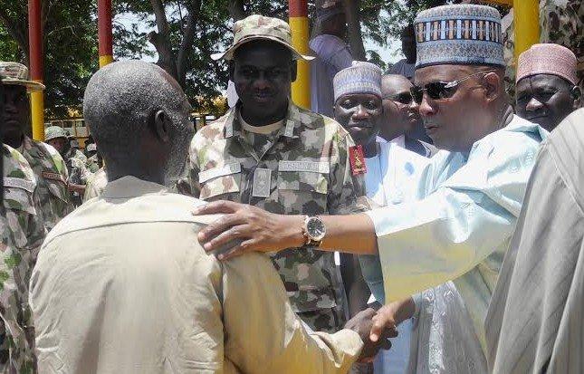 Nigerian Military handing over rescued victims to Borno state governor, Kashim Shettima. Photo: Premium Times