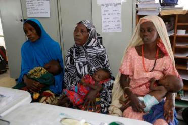 Mothers with their malnourished children wait for treatment at a clinic runs by Doctors Without Borders in Maiduguri, Nigeria, Monday Aug. 29, 2016. Children who escaped Boko Haram's Islamic insurgency now are dying of starvation in refugee camps in the biggest city in northeast Nigeria because officials are stealing food aid, workers say. (AP Photo/Sunday Alamba)