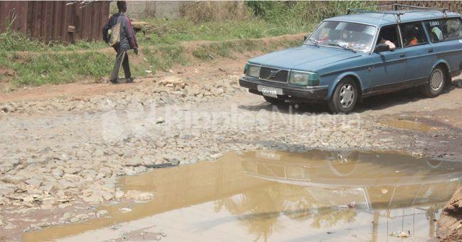 Motorists struggle to pass through the damaged section of the road. Photo by Patrick Egwu