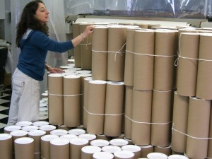 Retail Graphics Packaged in Tubes shows a woman counting them