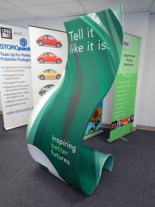 This is a fabric covered, double-sided curved base Banner Stand. Printing and fabric finishing by ICL Imaging