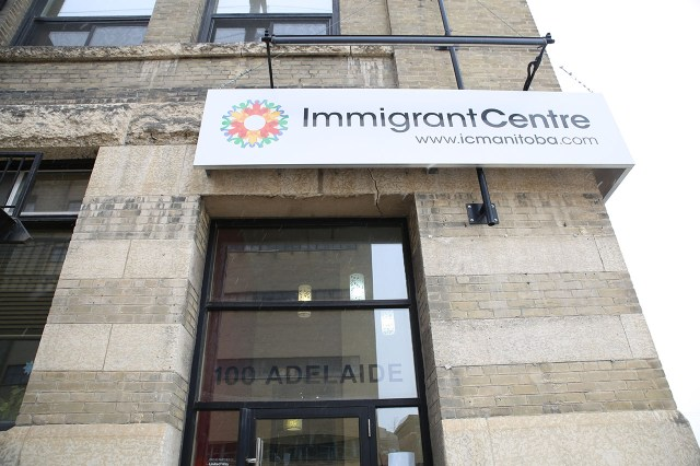 immigrant centre buliding exterior with close up of signage