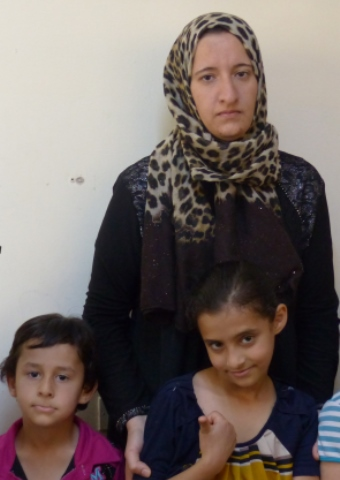 """Fatima"" and her two children are among the many displaced people being helped by Christians in the Middle East."