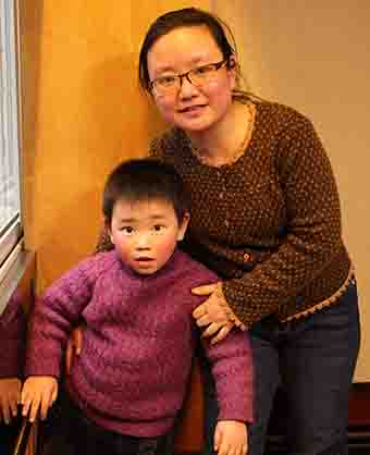 Pastor Yang Hua's wife and son