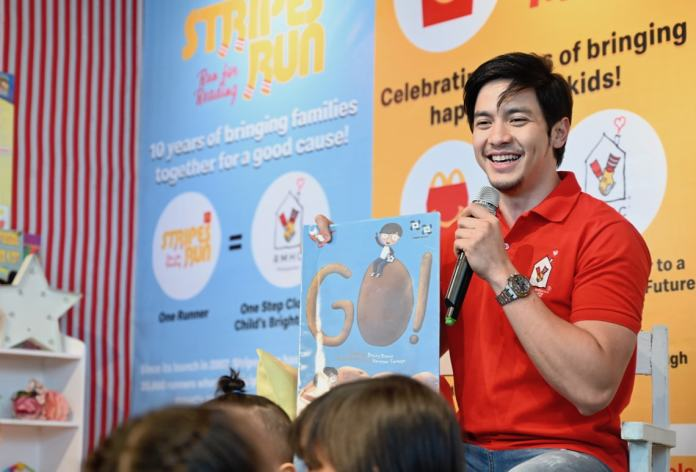 The newest RMHC celebrity ambassador Alden Richards read the book Go! to the kids from Bahay Bulilit