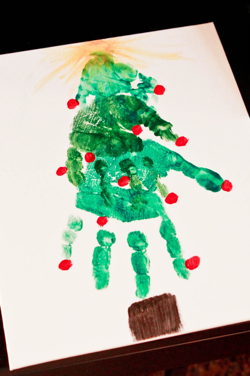 40+ Creative Handprint and Footprint Crafts for Christmas --> Handprint Christmas Tree