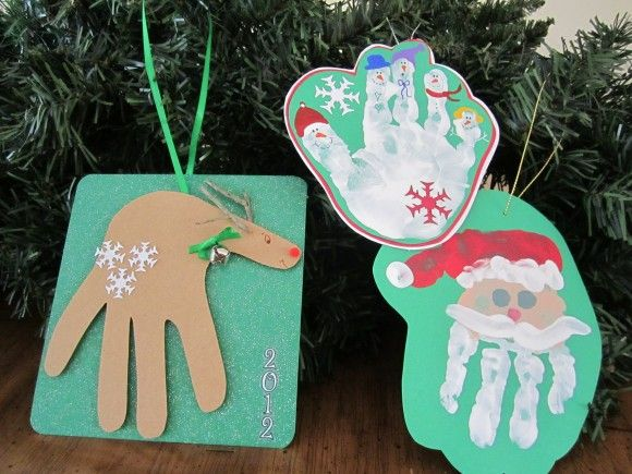 40+ Creative Handprint and Footprint Crafts for Christmas --> Hand Print Christmas Ornaments