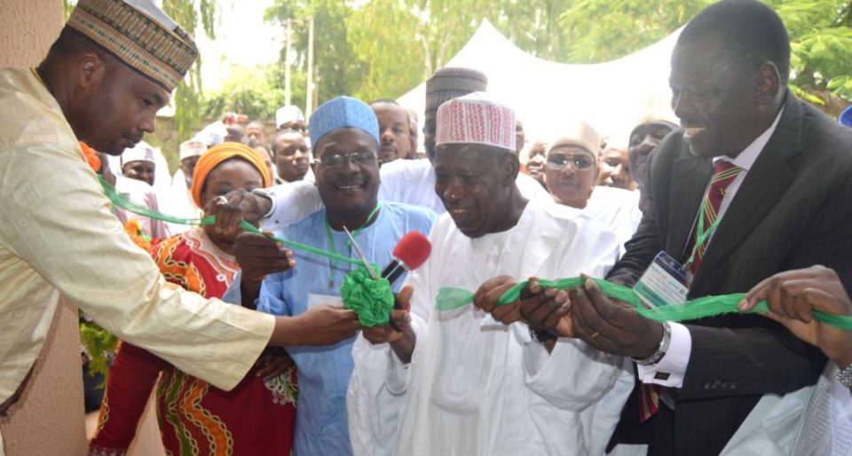 (L to R) Dr Hakeem Ajeigbe, Country Representative, ICRISAT-Nigeria (third from left), Dr Ganduje and Dr Tabo at the inauguration of the new office building. Photo: ICRISAT