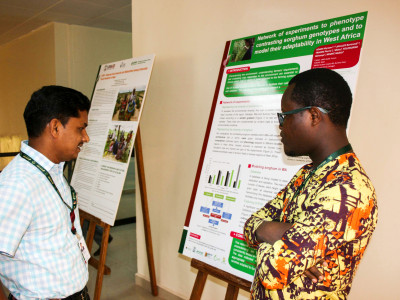 Dr Prakash Gangashetty, Post Doctoral Fellow, Pearl Millet breeding, with Dr Samuel Partey, Scientist, CCAFS at the poster session. Photo: A Diama, ICRISAT