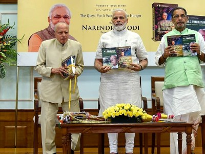 At the book launch. L-R: Prof MS Swaminathan, Prime Minister Narendra Modi and Minister of Agriculture, Radha Mohan Singh. Photo: PMO