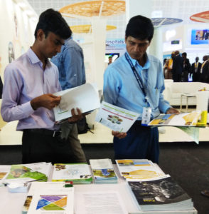 Visitors browsing through the literature at the ICRISAT stall Photo: ICRISAT
