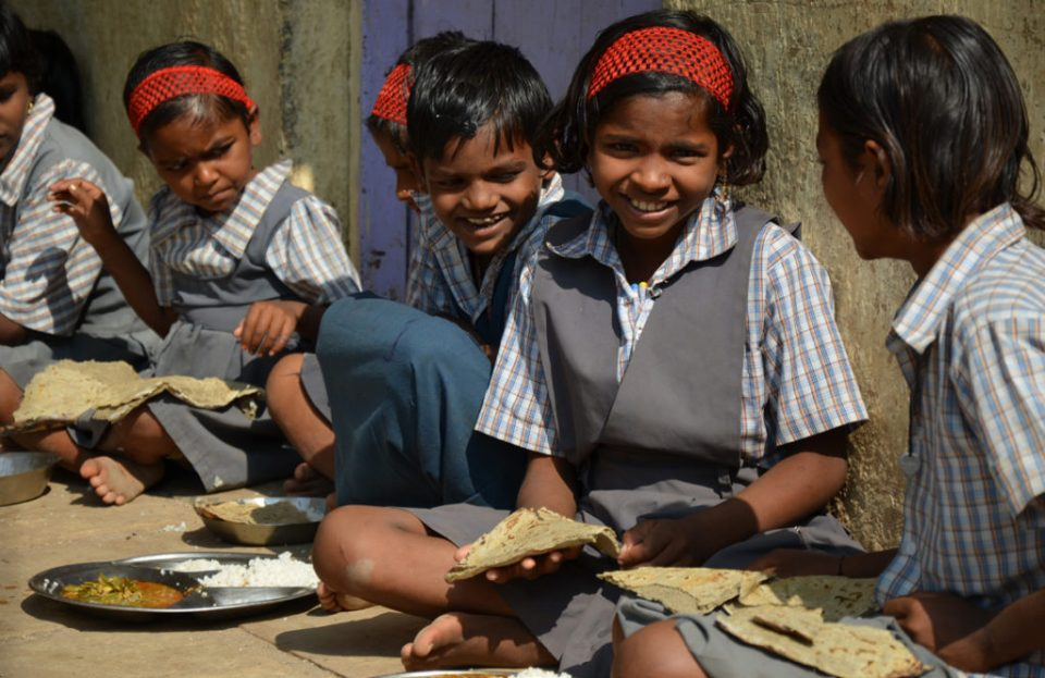 "School children in Maharashtra eating high iron pearl millet ""bhakri"" (flat bread) as part of their mid-day meal. Photo: Alina Paul-Bossuet, ICRISAT"