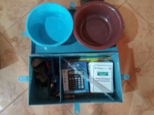 VSLA kit (calculator, membership card, metal box for savings and two plastic bowls to collect money during weekly meetings). Photo: A Diama, ICRISAT
