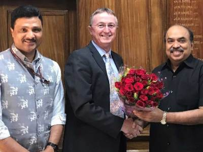 Mr Agarwal (extreme right) is warmly welcomed by Dr Carberry, while Dr Padhee looks on.