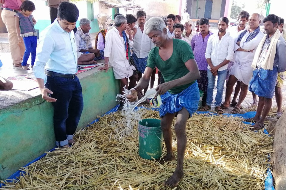 Farmers watch the demonstration of crop (pearl millet) residue enrichment at Lingadalli, Ballari. Photo: M Patil, ICRISAT
