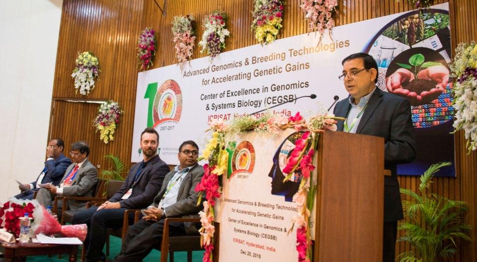 Dr Kiran K Sharma, Deputy Director General-Research, ICRISAT, speaking at the symposium. Photo: S Punna, ICRISAT