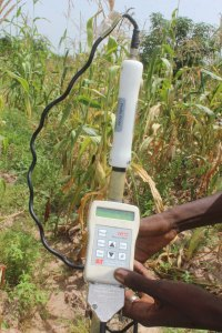 Use of soil moisture measurement device being shown to farmers in Bougouni. Photo: ICRISAT